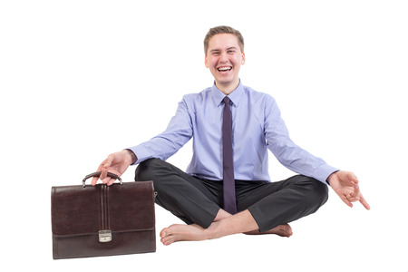 businessman relaxing after work in yoga pose photo