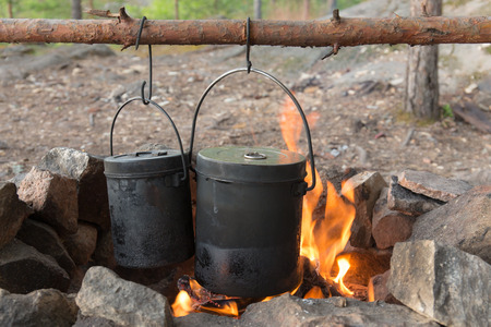 travel pots on the fire in the hearth photo