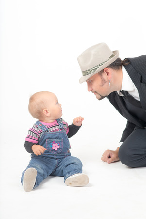 communicates: father communicates with a small baby daughter