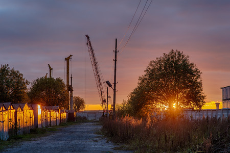 industrial landscape on the construction site at sunset photo