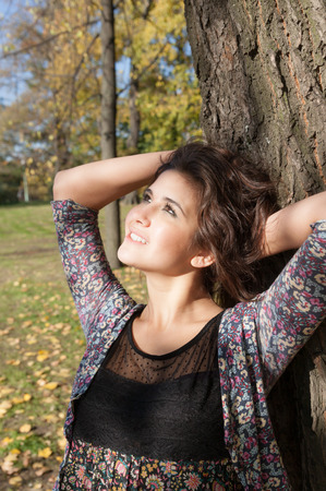 Portrait of a sensual girl in autumn park photo