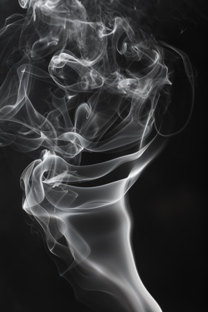 smooth white smoke on a black background, abstract photo