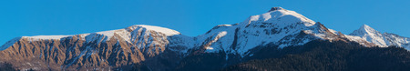 panorama of the peaks of the mountain range photo