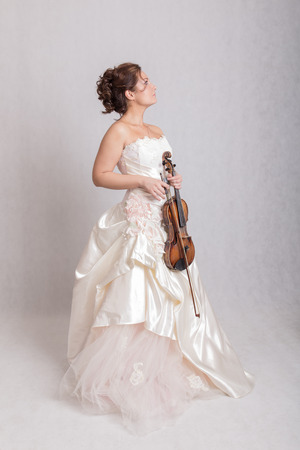 woman violin: girl in a white dress with violin