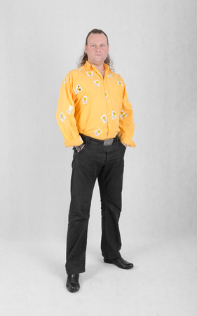 yellow shirt: Portrait of a confident man in a yellow shirt