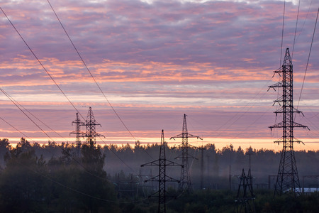 dawn sky: Towers of an electric main against dawn sky