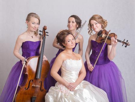 trio: bride in a white dress and a musical trio