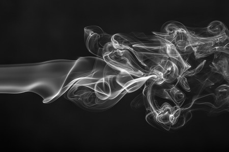 contrasts: White smoke on black background close up