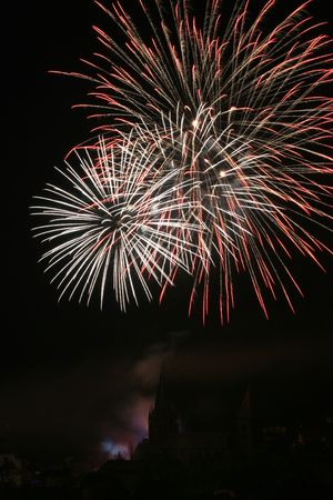 silhoutted: Fireworks on whitsun in Wissembourg a historical city in Alsace - France.