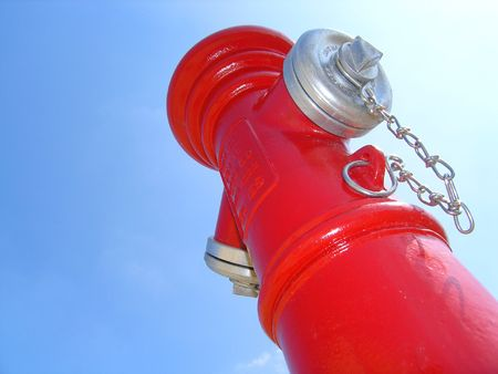 allow: Brand new fire-plug with blue sky in the background. Off center to allow insertion of text or images. Stock Photo