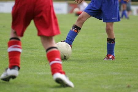 footwork: Young soccer players Stock Photo