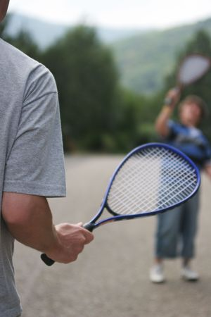 Father and son playing badminton. Stock Photo