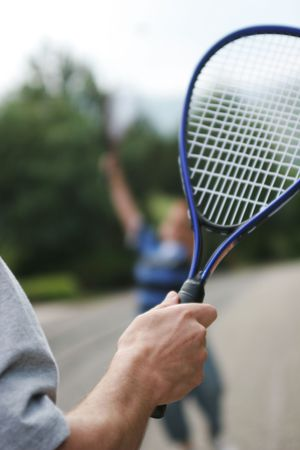 Father and son playing badminton. photo