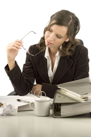 Young businesswoman sitting at a desk with folders Stock Photo - 802862