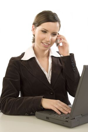 Young attractive woman working with laptop and cell phone photo