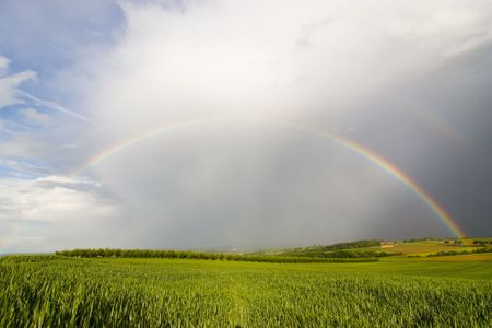 Complete rainbow over a rural landscape on a stormy day Stock Photo - 923130