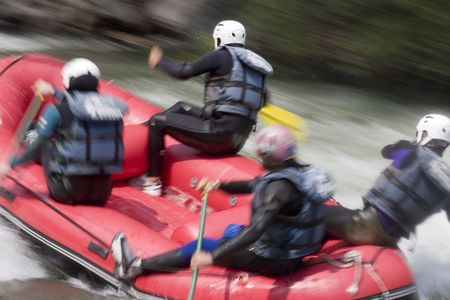 persevere: Whitewater rafting on a mountain river. With tripod and long exposure time - motion blurred.