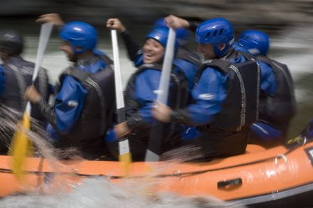 Whitewater rafting on a mountain river. With tripod and long exposure time - motion blurred.