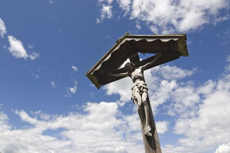 almighty: Wooden cross in against cloudscape