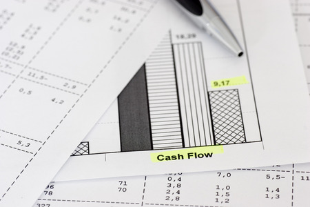 cash flow statement: Business papers with ballpen focus on the words cash flow