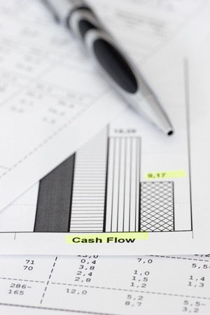 cutback: Business papers with ballpen focus on the words cash flow