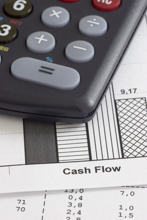 cutback: Business papers and calculator - focus on the words cash flow
