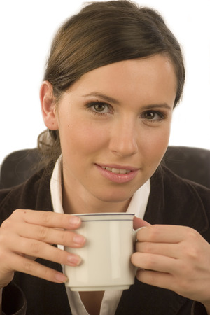Young attractive businesswoman with a cup in her hand Stock Photo - 1622781