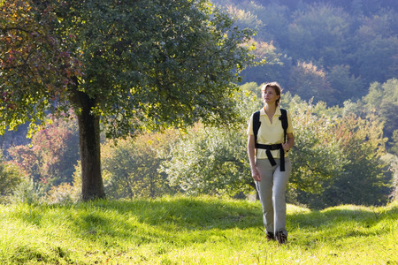 Hiking woman at sunset with the colors of fall Stock Photo - 1728537