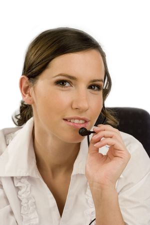 Attractive smiling young woman talking with headset photo