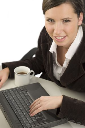 Young smiling woman working with a computer in an office Stock Photo - 2575748