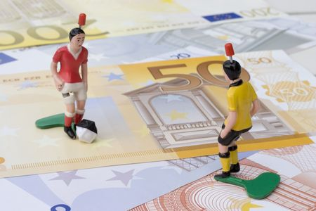 Figures of footbal players on euro banknotes Stock Photo