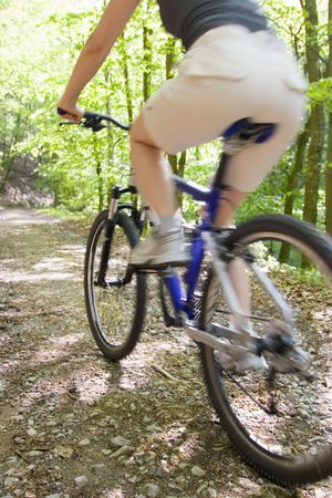mountainbike: Woman riding mountainbike in a forest
