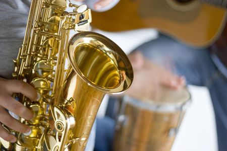 Close-up of a music band. Focus on the saxophone in the foreground Stock Photo - 3068235