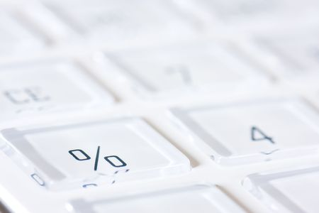 compute: White calculator. Focus on the per cent key.