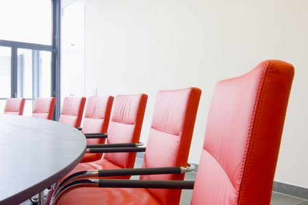 Red leather chairs in a conference room Stock Photo