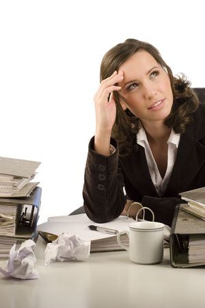 disordered: Pensive businesswoman sitting at a desk in an office Stock Photo