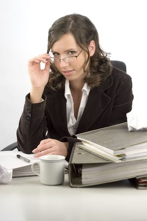 Young businesswoman sitting at desktop with folders Stock Photo - 3596198