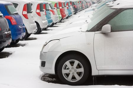 Stocked cars covered with snow in winter