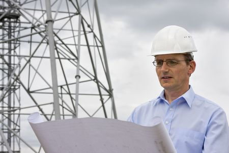 Engineer reading a plan on construction side Stock Photo - 5469576