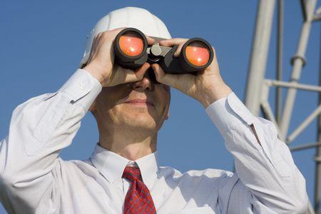 rick: Engineer with binoculars on construction site