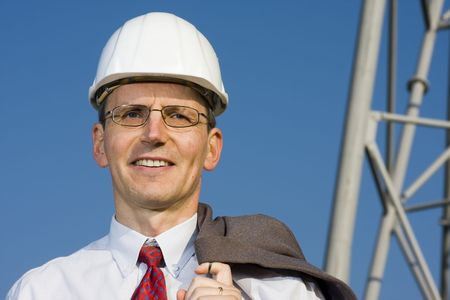 Smiling engineer in front of steel construction  photo