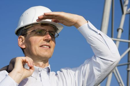 Engineer searching in front of steel construction Stock Photo