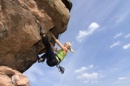 to climb: Young woman climbing an extreme rock - Charlotte Frank at the Windstein - Vosges - France Stock Photo