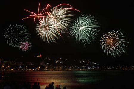 beach happy new year: Fireworks celebrating new year on the beach of Bombinhas in Brazil