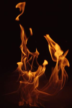 heat radiation: flames dancing in the dark Stock Photo