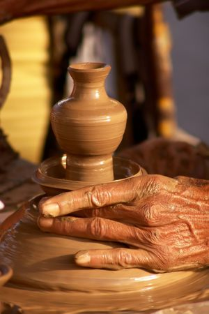 craftwork: Old hands working in clay