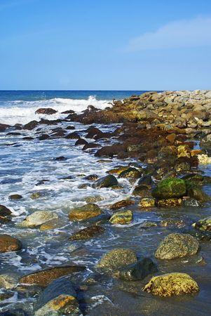 braking: Rocks at the beach braking waves