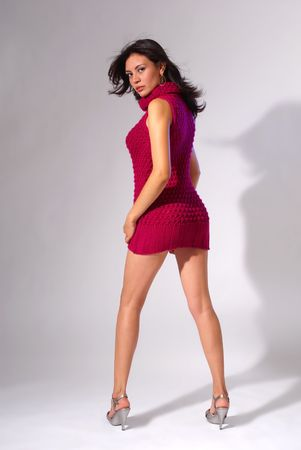 Sexy brunette in a red dress photo