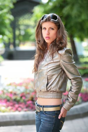 silvery: portrait of the dark-haired girl in silvery jacket Stock Photo