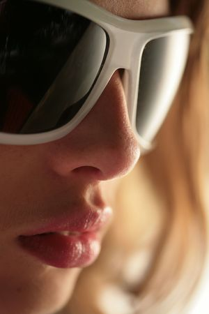 briliance: close-up, part of face in the fashionable sunglasses
